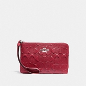 30049 corner zip wristlet in signature leather