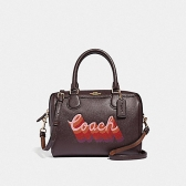 38996 mini bennett satchel with neon coach script