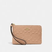 67555 corner zip wristlet in signature leather