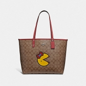 72900 reversible city tote in signature canvas with ms. pac-man