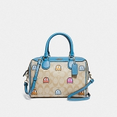 73067 mini bennett satchel in signature canvas with pac-man ghosts print