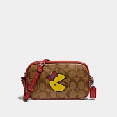 73446 crossbody pouch in signature canvas with ms. pac-man