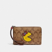 75594 corner zip wristlet in signature canvas with ms. pac-man