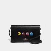 75605 hayden foldover crossbody clutch with pac-man animation
