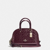 55450-iml7c mini sierra satchel in signature debossed patent leather