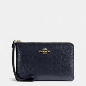 58034 corner zip wristlet in signature debossed patent leather