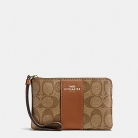 58035 corner zip wristlet in signature coated canvas with leather stripe